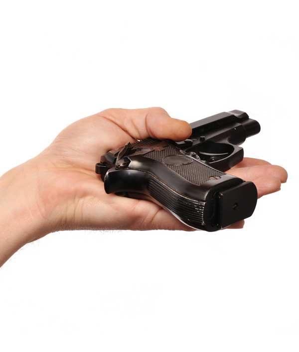 hand surrendering an old hand gun